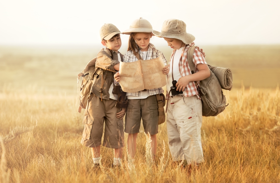 shutterstock_211599823_children_exploring_map_journey